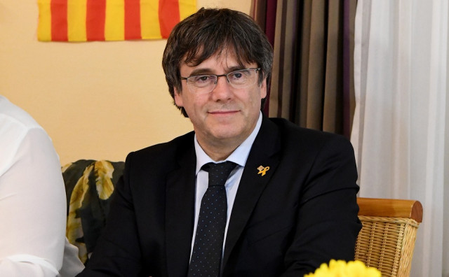 Carles Puigdemont attends a dinner with supporters